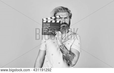 Favorite Series. Action. Cinema Production. Creative Producer. Bearded Man Hold Movie Clapper. Film