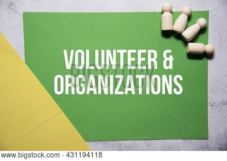 Volunteer And Organizations Text On Green And Yellow Background Flat Lay Concept. Suitable To Used A