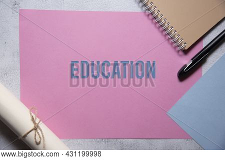 Education Text On Pink And Blue Background Flat Lay Concept. Suitable To Used As Title Cover Each Su