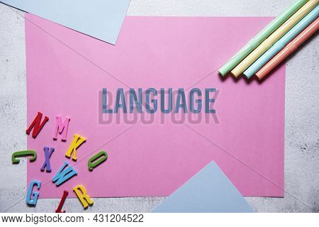 Language Text On Pink And Blue Background Flat Lay Concept. Suitable To Used As Title Cover Each Sub