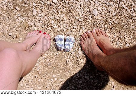Happy Young Family Awaiting Baby, Love And Happiness. Future Mom And Dad Feet With Little Unborn Bab