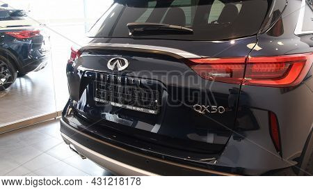 Closed Car Trunk Of Infiniti Qx50. Chrome Logo On Polished Black Car Back Side Without License Plate