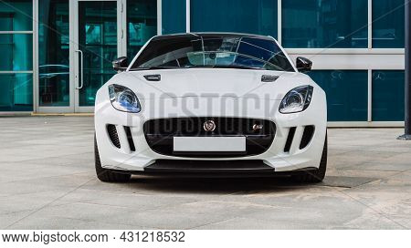Moscow, Russia - August 2021: Jaguar F-type S Coupe Parked On The Street In Moscow. White Supercar I