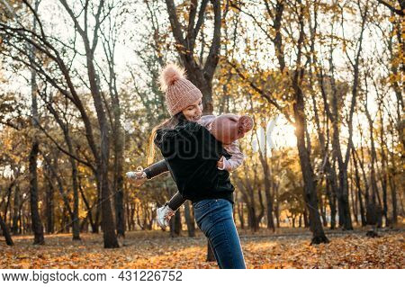 Family Fall Social Distancing Activities. Happy Family Mom And Toddler Baby Girl Playing Outdoors In