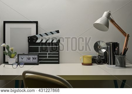 Front View And Mock Up With Office Desk, Clapper Board, Photo Frame, Table Clock, Camera, Books,  Ta