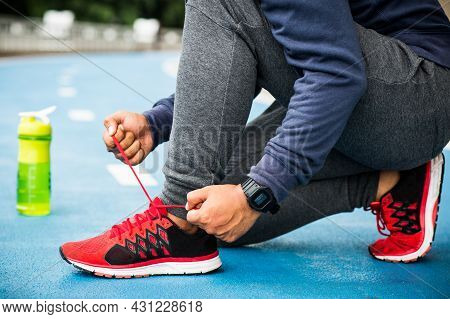 Close Up Running Man Tying Shoelaces Sport Concept.