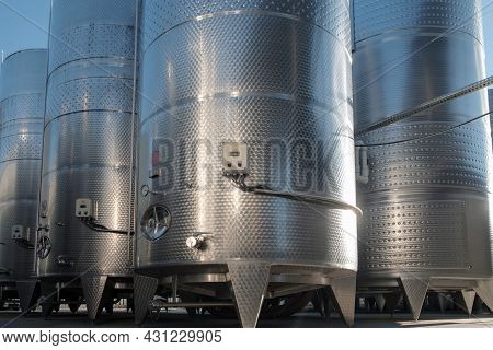 Stainless Tanks For Processing And Fermentation Wine Production In The Open Air With Blue Sky Backgr