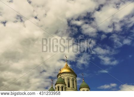 Golden Brilliant Dome Of A Christian, Orthodox Church With A Christian Orthodox Cross Close-up Again
