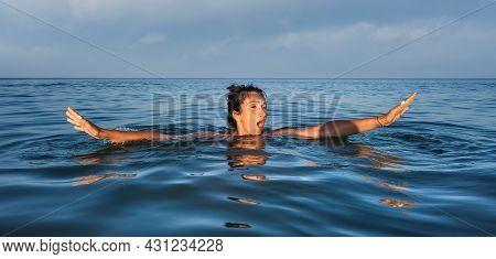Woman Swims In The Sea