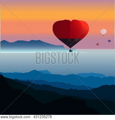 Hot Air Balloon In The Valley Above The Lake