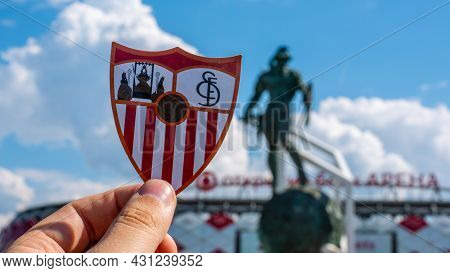 June 14, 2021 Seville, Spain. The Emblem Of The Football Club Sevilla Fc Against The Background Of A