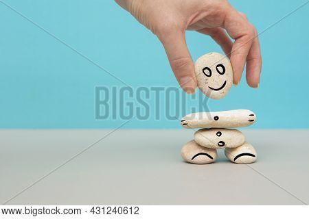 Hand Setting White Natural Stone Stack To Balance With Smiling Face. Mental Healthcare, Concept With