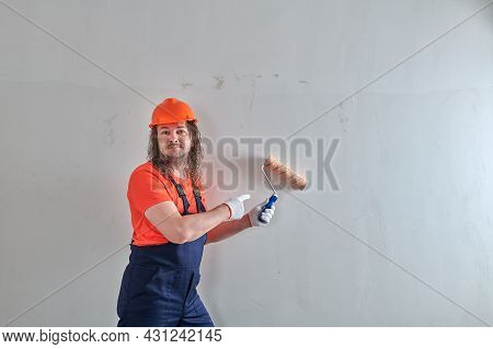 Funny Painter Paints The Wall With A Roller