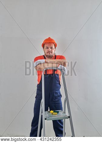 A Brooding Repairman Leaned On A Stepladder