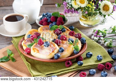 Gourmet Breakfast - Cottage Cheese Pancakes, Syrniki, Curd Fritters With Raspberry, Blueberry, Black