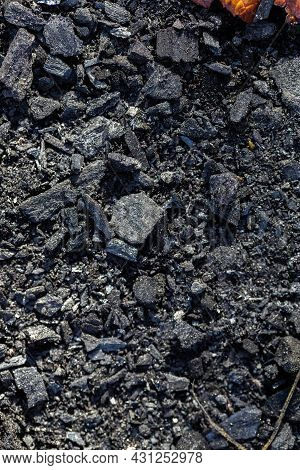Black Coal. Scattered Pieces Of Coal. Camping Fire. Black Background