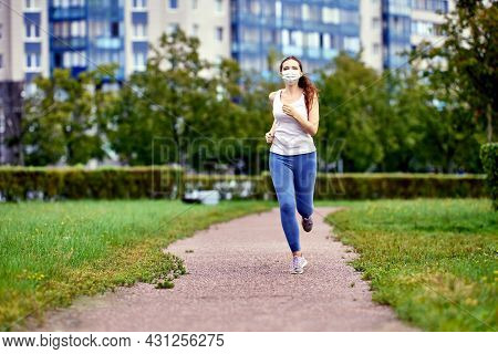 Runner Trains In Facial Mask As Protection From Covid-19.