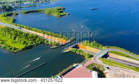 Aquaduct Veluwemeer, Nederland. Aerial View From The Drone. A Sailboat Sails Through The Aqueduct On