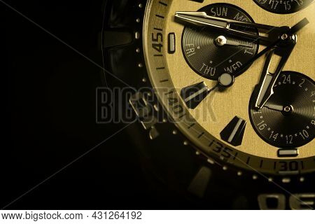 Macro Photo. Time. The Dial Of A Modern Wristwatch. The Arrows Show The Time. Selective Focus.