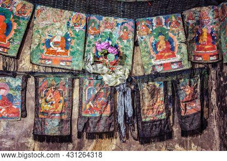 Thankas - Buddhist religious paintings on silk. Thiksey gompa (Tibetan Buddhism monastery), Ladakh, India