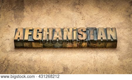 Afghanistan word abstract in vintage letterpress wood type printing blocks against abstract textured bark paper