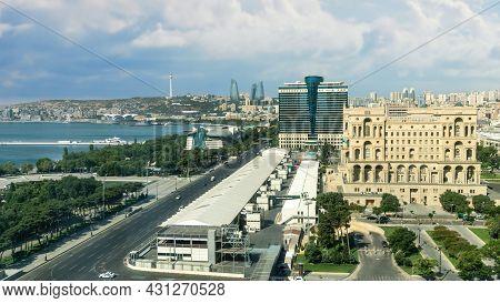Baku, Azerbaijan - July 2019: Baku Cityscape With Caspian Sea, Azeri Parliament And Flame Towers.