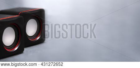 Music Banner With Two Small Black Music Speakers With Red Inserts. Minimalist Photo Of Music Speaker