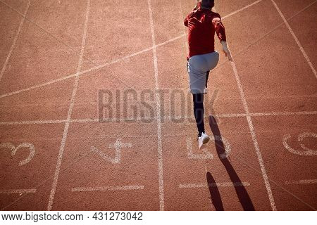 Sprinter taking off from starting block on running track.Sports concept.