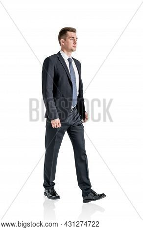 Young Ambitious Businessman Wearing Formal Suit Is Walking. Concept Of Contemporary Successful Busin