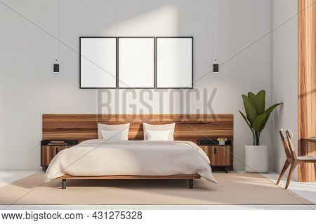 Three Posters In An Interior With A Modern Bed With Wood Headboard And Bedstands, An Indoor Plant An