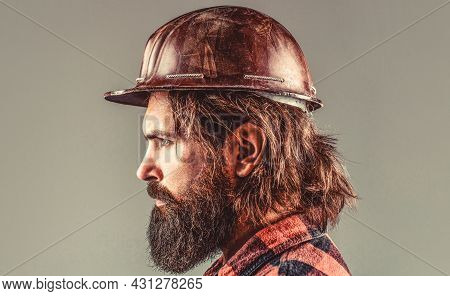 Building, Industry, Technology - Builder Concept. Bearded Man Worker With Beard In Building Helmet O