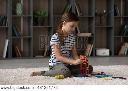 Joyful Small Preteen Kid Girl Playing Toys At Home.