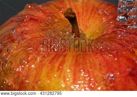 Red Ripe Sweet Apple Under A Stream Of Clean Water Close Up Macro Photography