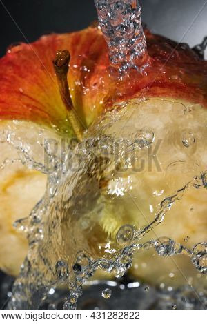 Half Of A Red Ripe Sweet Apple Under A Stream Of Clean Water Close-up Macro Photography