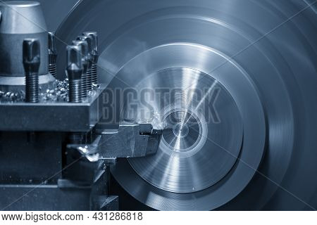 The Lathe Machine Operation By Face Cutting Metal Parts By Lathe Tools. The Metalworking Process By