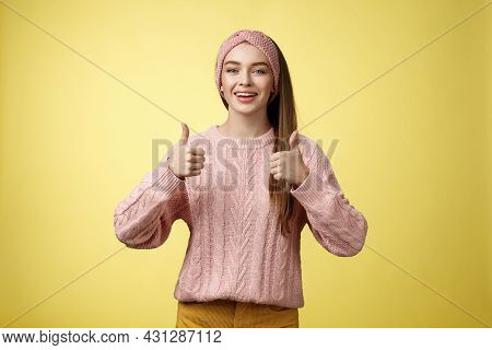 Attractive Positive Young Girl In Knitted Sweater Agree With Suggestion, Approving Plan, Showing Thu