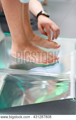 Orthopedic Insole. The Orthopedist Works With The Patient. Orthopedic Clinic. Choice Of Insoles In A