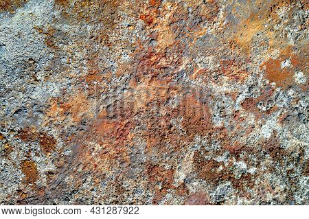 Rough Stone Surface With Spots Of Rusty Red And Grey. Colorful Texture In Old Copper Mine