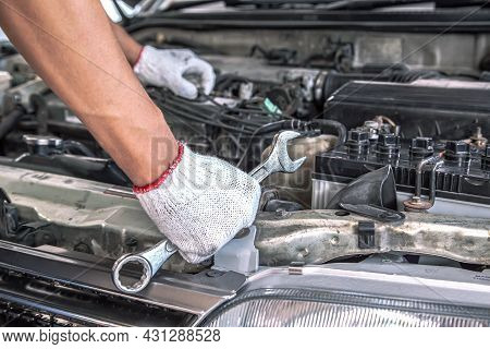 Car Care Maintenance And Servicing, Close-up Hand Technician Auto Mechanic Using The Wrench To Repai