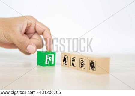 Fire Prevention, Close-up Hand Choose Cube Wooden Block Stack With Door Exit Sing Or Fire Escape And