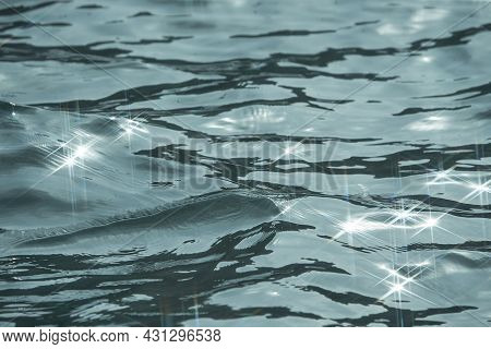 Detail Of A Sunlight Reflecting In Glittering Sea. Sparkler In Water - Background. Sea Water With Su