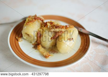 Cepelinai, Dumplings Made Of Grated And Riced Potatoes And Stuffed With Ground Meat, Dry Curd Cheese