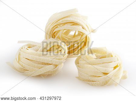 Uncooked Tagliatelle Pasta Isolated On White Background With Clipping Path