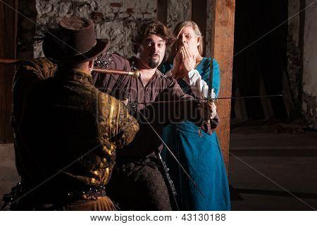 Swordsman Defending Lady