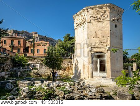 Tower Of Winds Or Aerides In Roman Agora, Acropolis In Distance, Athens, Greece. It Is Tourist Attra