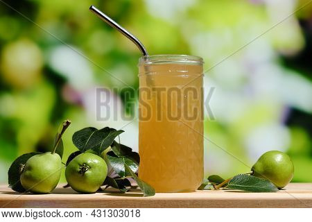 Pear Juice On Wooden Table Outdoors. Glass Of Juice And Pears Fruits, Summer Garden On Background. H