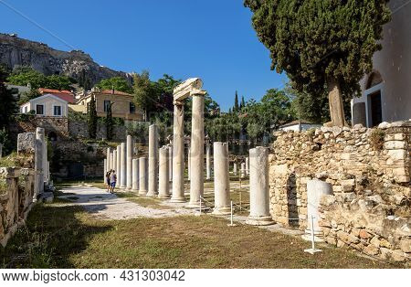 Roman Agora In Athens, Greece. Famous Acropolis In Distance. This Place Is Tourist Attraction Of Ath