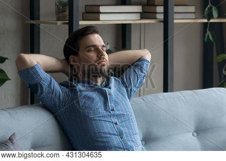 Calm Peaceful Millennial Man Taking Break And Deep Breath