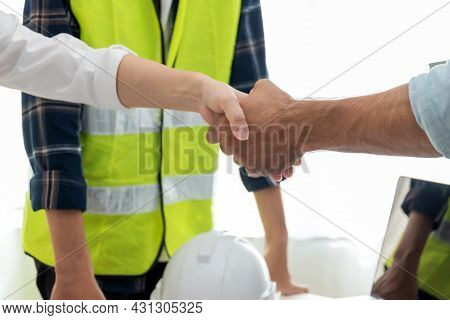 Contractor. Architect And Engineer Group Construction Worker Partner Handshake In Meeting Room Offic