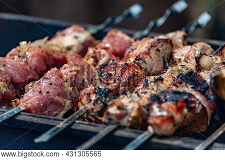 Fresh Shish Kebab On Skewers Is Fried On The Grill.